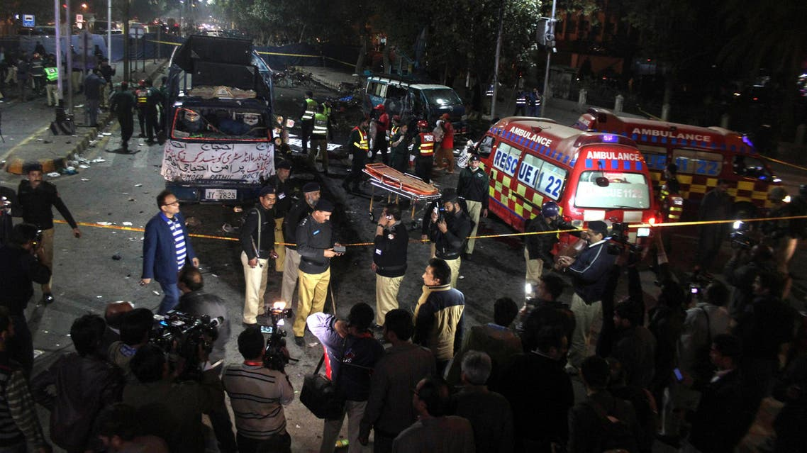 Police and rescue workers work at the scene of a blast in Lahore, Pakistan February 13, 2017