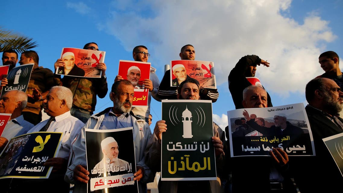 Supporters of Sheikh Raed Salah, head of Islamic Movement's northern branch, protest in the Israeli-Arab town of Umm el-Fahm against the initial approval of a bill to enforce lowering the volume of mosque loudspeakers calling worshippers to prayer, November 17, 2016. (Reuters)