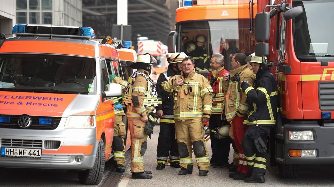 Firemen outside the Helmut Schmidt airport in Hamburg, Germany February 12, 2017 (Photo: Reuters/Fabian Bimmer)