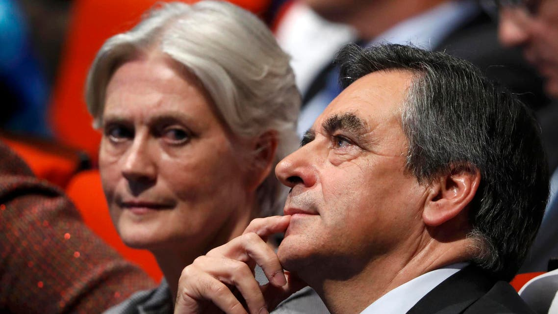 French politician Francois Fillon, member of the conservative Les Republicains political party and his wife Penelope (L) attend a final rally ahead of the first round of vote to choose the conservative candidate for France's presidential election in Paris, France, November 18, 2016