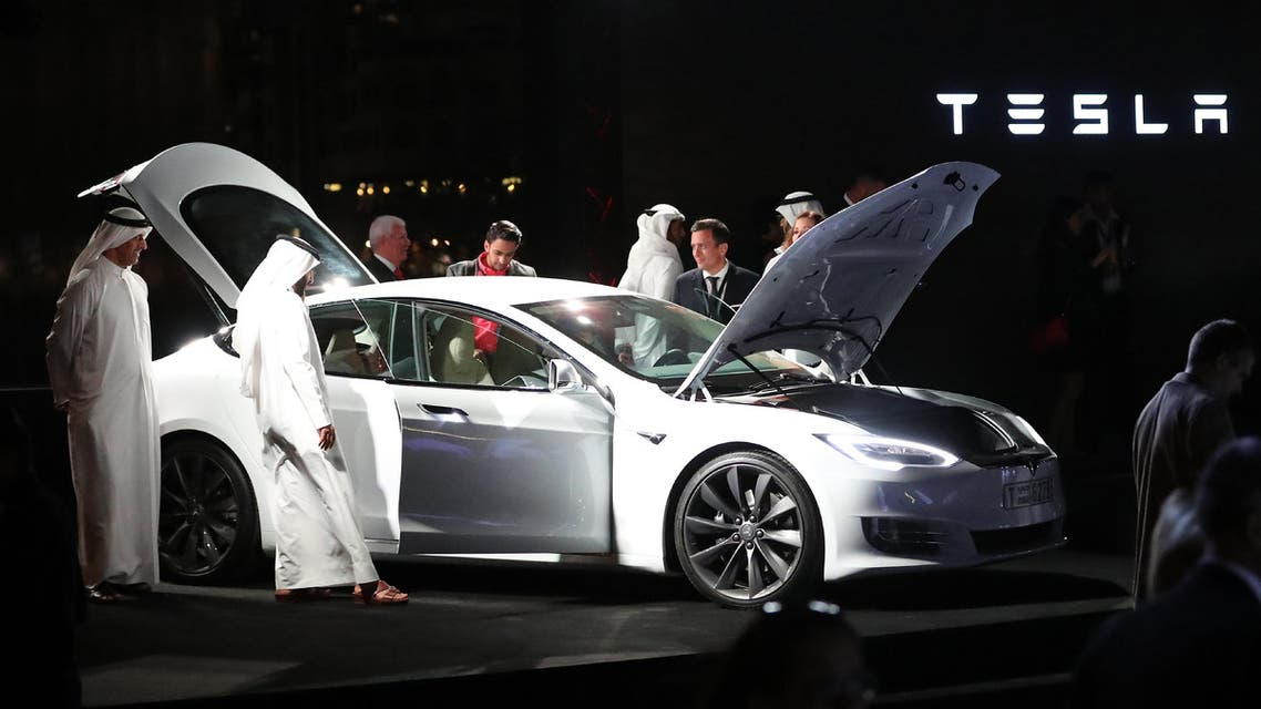 Emirates check a vehicle manufactured by Electric carmaker Tesla during a ceremony in Dubai, on February 13, 2017. AFP