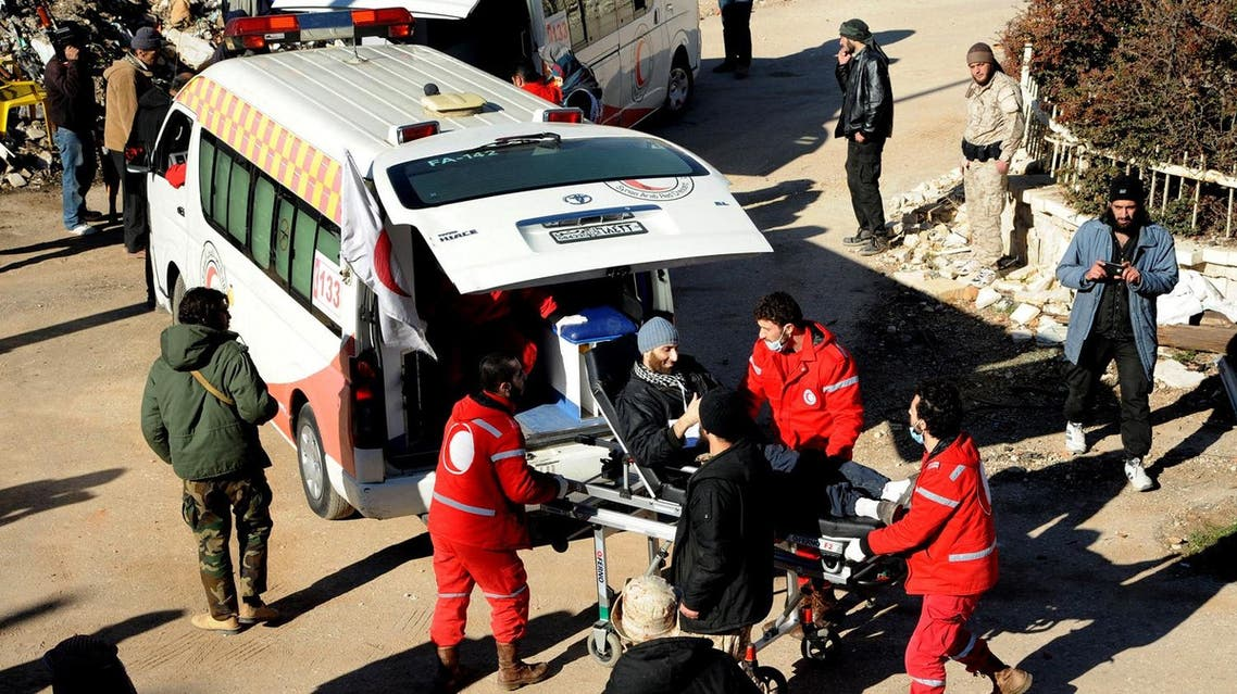 In this file photo released on December 28, 2015, by the Syrian official news agency SANA, Syrian Red Crescent workers carry a wounded Syrian opposition fighter, during an evacuation from the town of Zabadani, in Syria. A young man has died of malnutrition and a surgeon killed by a sniper in two besieged towns in western Syria this past month in a stark reminder that sieges continue to kill Syrians despite international efforts to defuse them in halting negotiations in Europe. (SANA via AP, File)