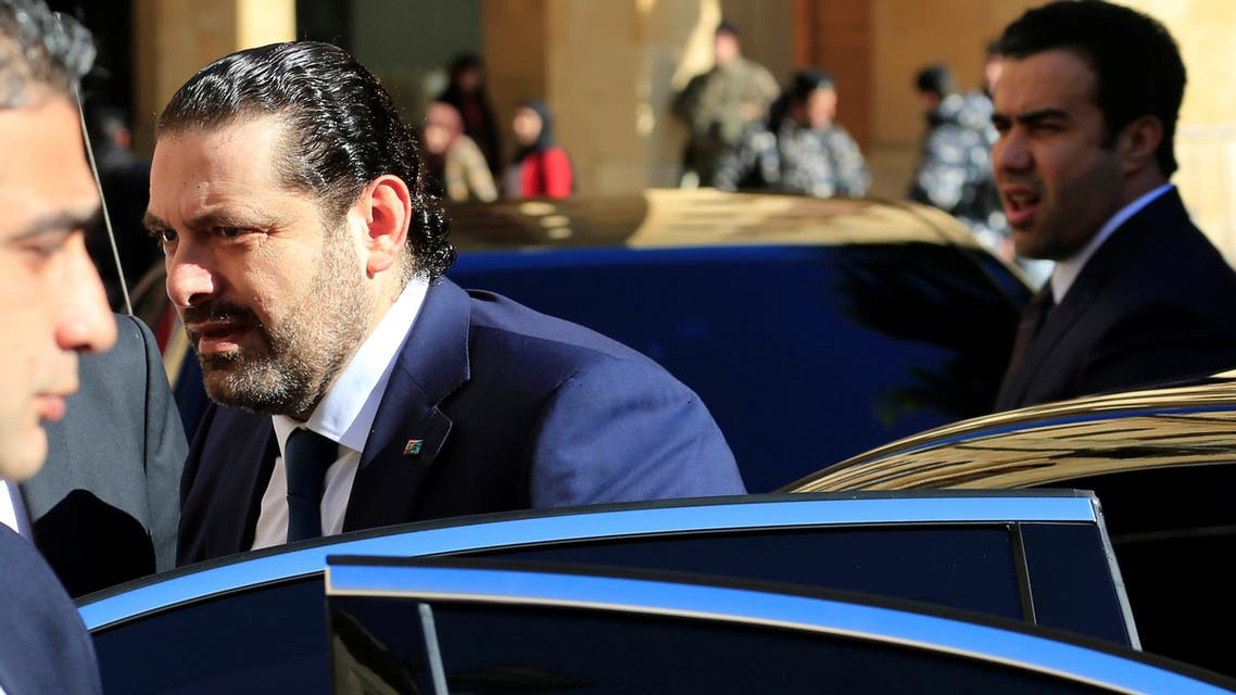 Lebanon's Prime Minister Saad al-Hariri (C), gets out of a vehicle outside the Parliament building before his new government won a vote of confidence in parliament in downtown Beirut, Lebanon December 28, 2016. REUTERS/Jamal Saidi