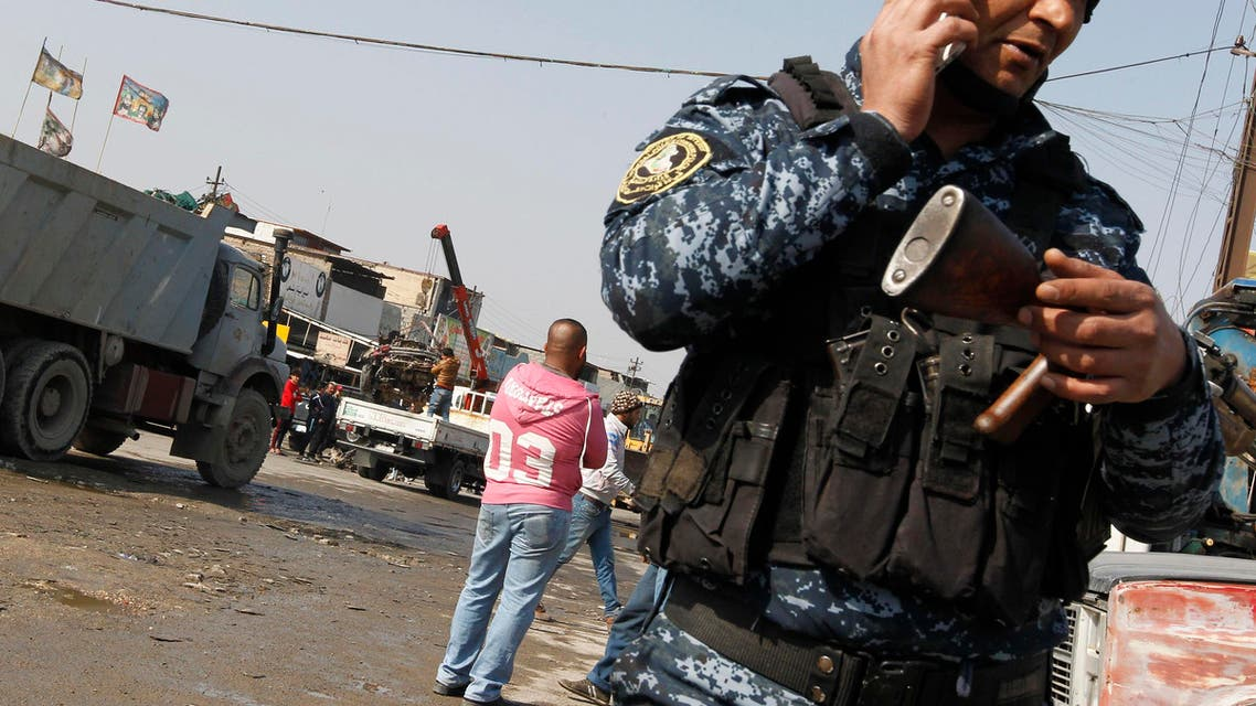 Iraqi police check the site where a car bomb exploded in an industrial area of south Baghdad on February 14, 2017 killing at least four people. (AFP)
