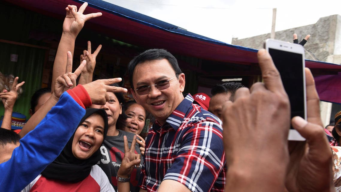 Jakarta governor Basuki Tjahaja Purnama (C) take pictures with residents during his campaign at Jatinegara district in Jakarta, Indonesia, February 6, 2017 in this photo taken by Antara Foto. Picture taken February 6, 2017. Antara Foto/Hafidz Mubarak/ via REUTERS ATTENTION EDITORS - THIS IMAGE WAS PROVIDED BY A THIRD PARTY. FOR EDITORIAL USE ONLY. MANDATORY CREDIT. INDONESIA OUT.