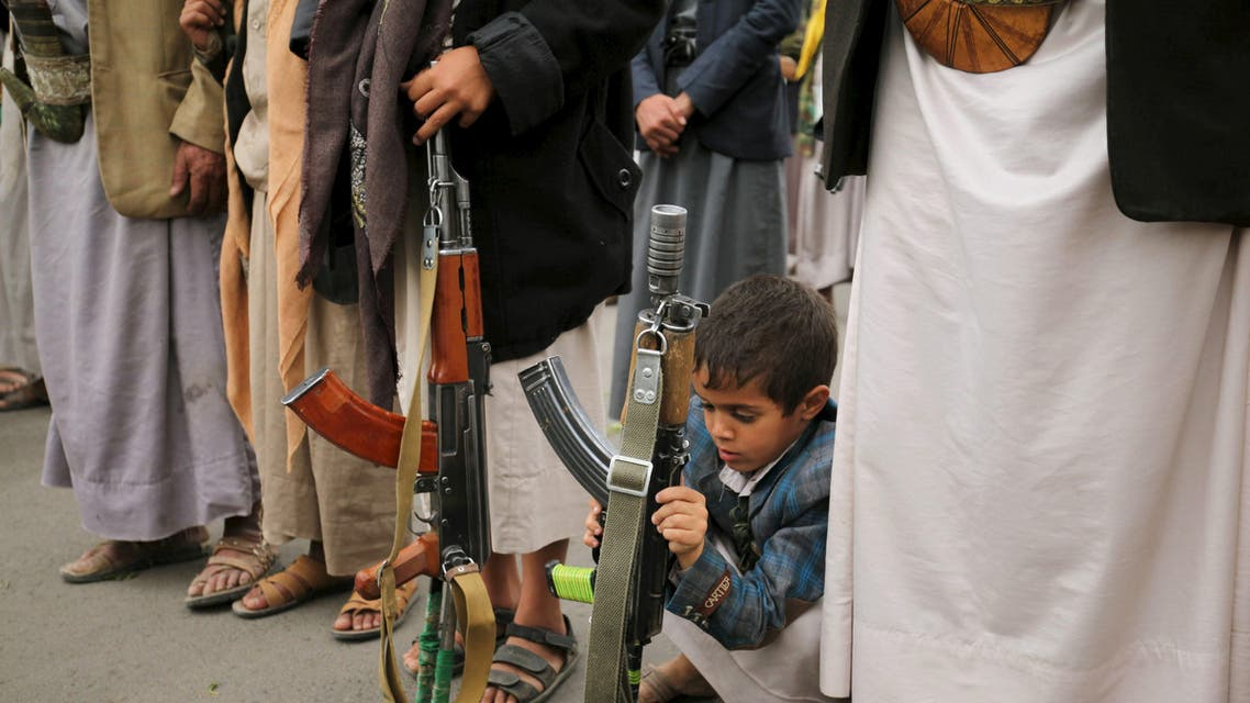 A boy holds his father's rifle during a rally by followers of the Houthi movement against the Saudi-led coalition in Yemen's capital Sanaa, August 11, 2015. afp