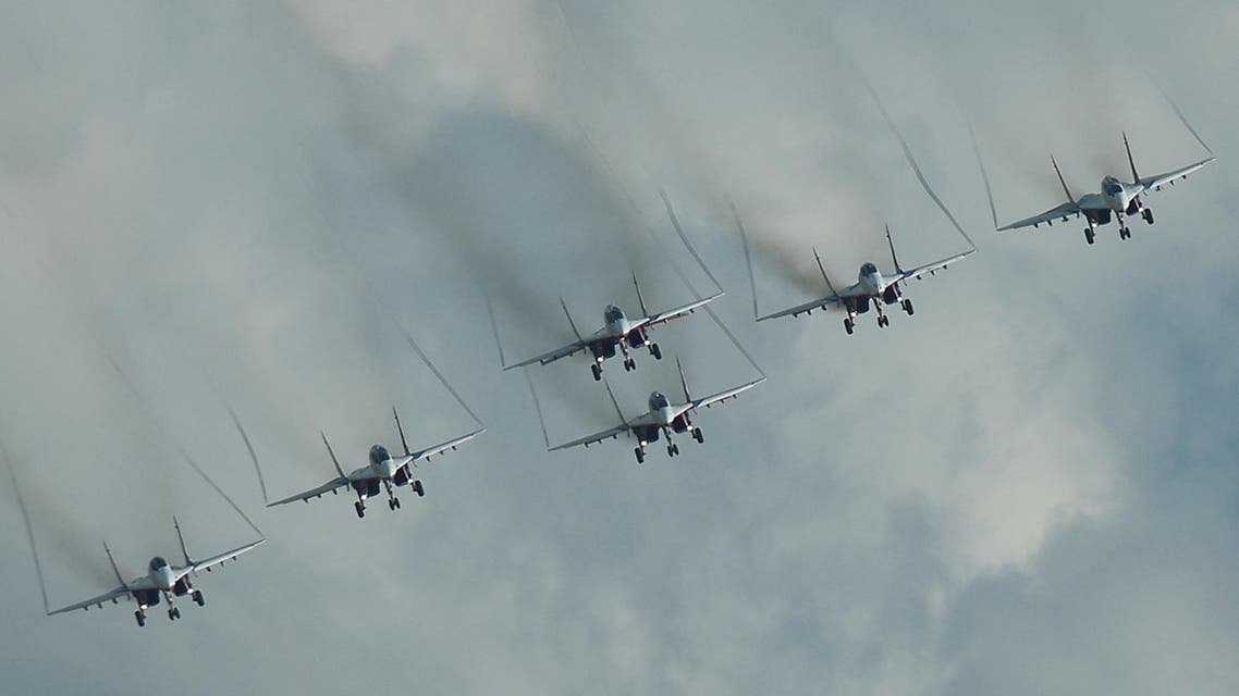 Mikoyan MiG-29 jet fighters of the Strizhi (Swifts) aerobatic team fly in formation during the International Army Games 2016, in Dubrovichi outside Ryazan, Russia, August 5, 2016. (Reuters)