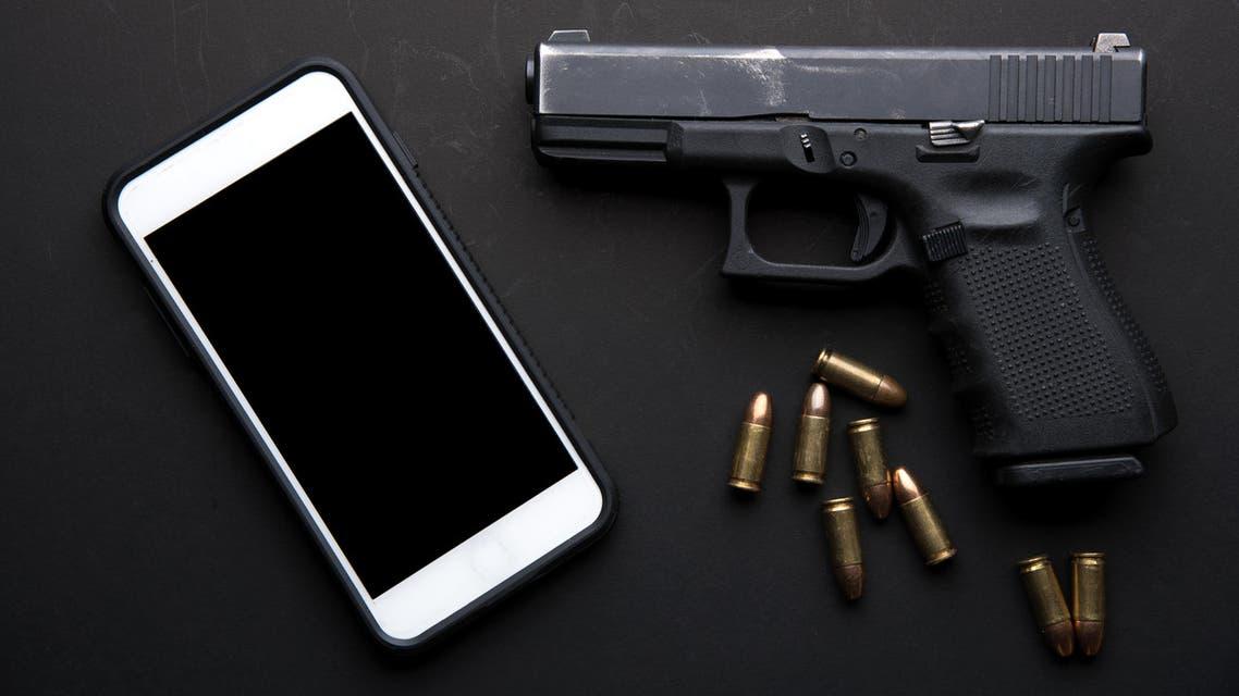 shutterstock gun phone