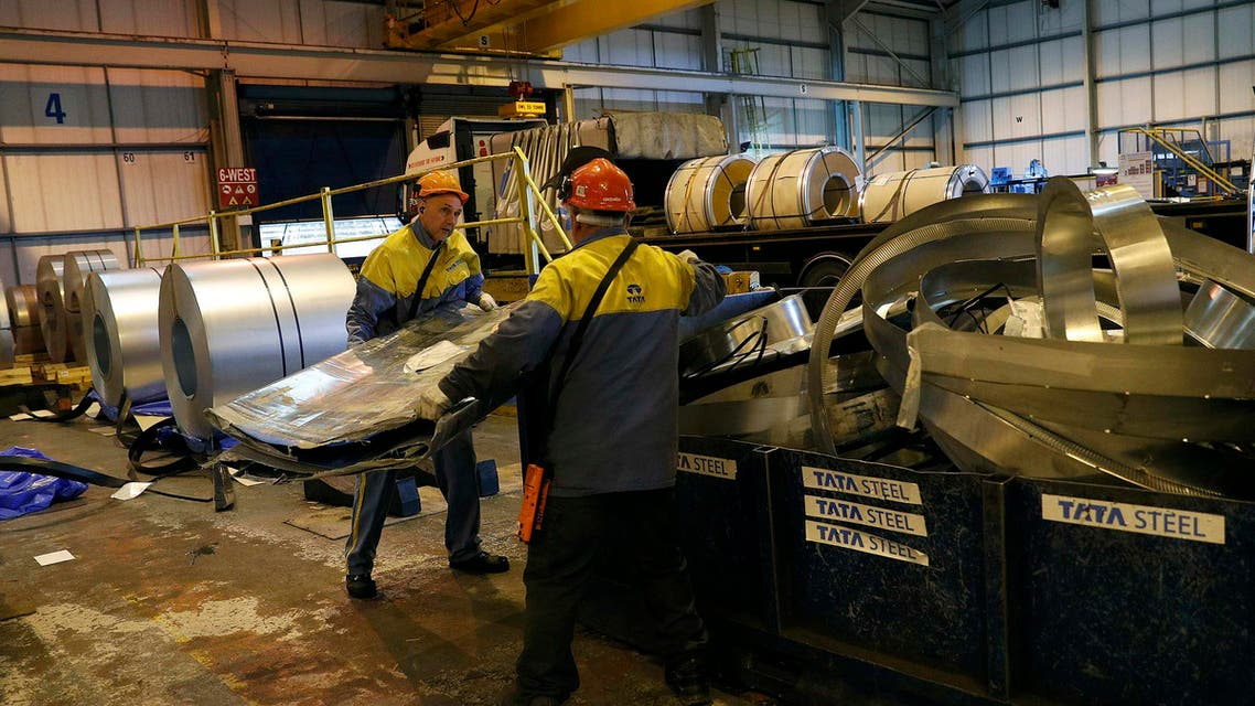 Workers move waste metal at Tata Steel's new robotic welding line at their Automotive Service Centre in Wednesfield, Britain, on February 15, 2017.(Reuters)
