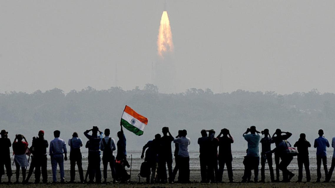 Indian onlookers watch the launch of the Indian Space Research Organization (ISRO) Polar Satellite Launch Vehicle (PSLV-C37) at Sriharikota on Febuary 15, 2017. (AFP)