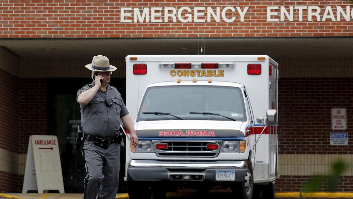 A law enforcement officer walks in front of an ambulance at the Alice Hyde Medical Center in Malone, New York June 28, 2015.  Reuters