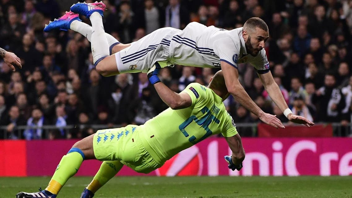Karim Benzema dives over Napoli's goalkeeper during the UEFA Champions League match in Madrid on February 15, 2017. (AFP)