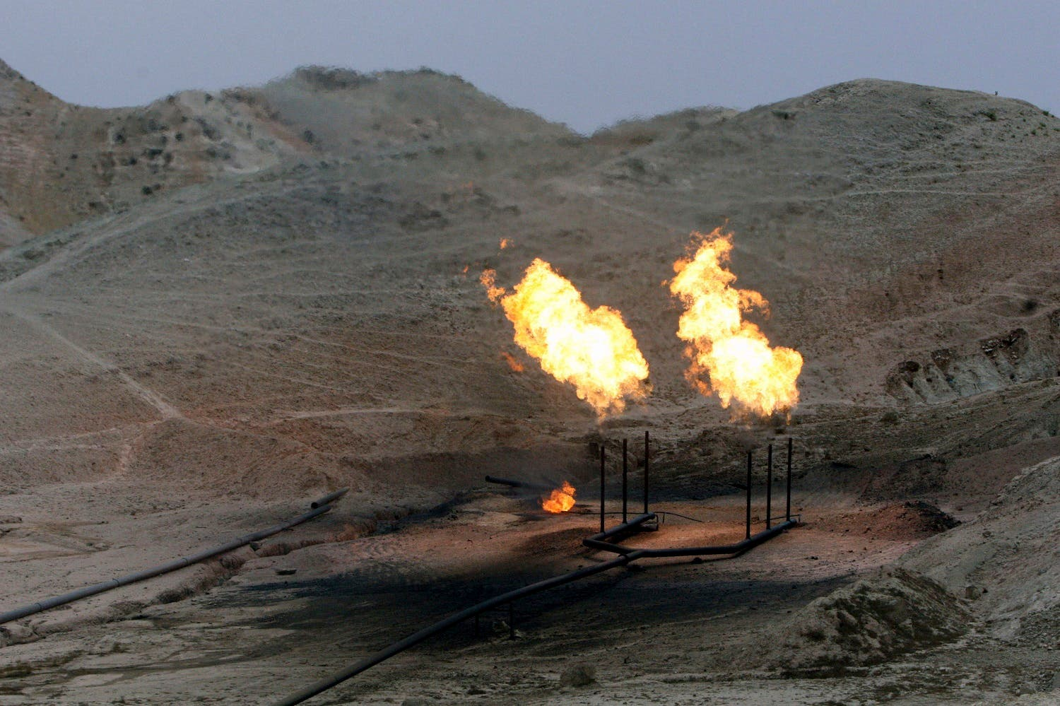 Gas flares burn near an oil well on the outskirts of Masjed Soleiman, a city where some of the first modern oil wells were discovered and drilled in the Middle East, in Khuzestan province. (File photo: AP)