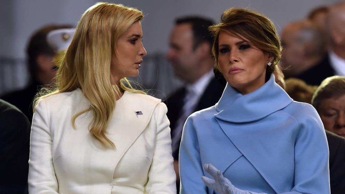 US First Lady Melania Trump speaks with Ivanka Trump during the presidential inaugural parade for US President Donald Trump on January 20, 2017 in Washington, DC
