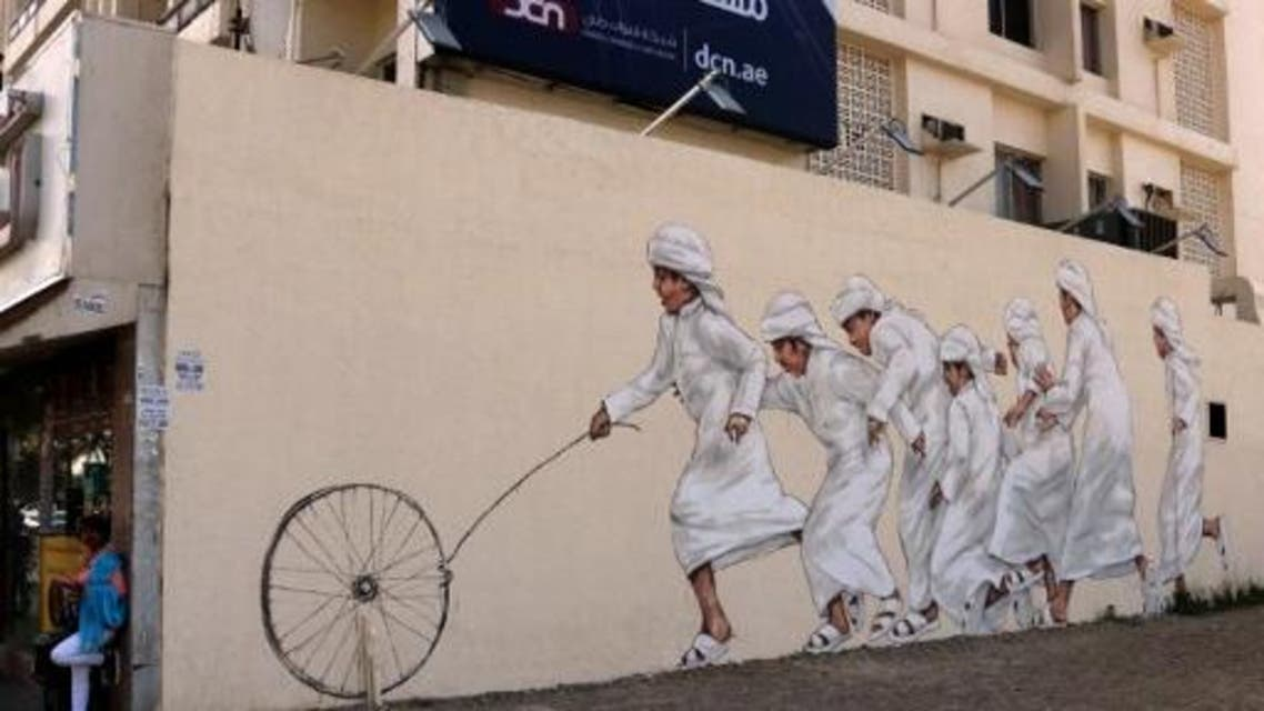 A picture taken on February 6, 2017 shows graffiti by Malaysian-based Lithuanian artist Ernest Zacharevic on a wall of Dubai's 2nd of December street, which is part of the government-funded Dubai Street Museum project. (AFP)