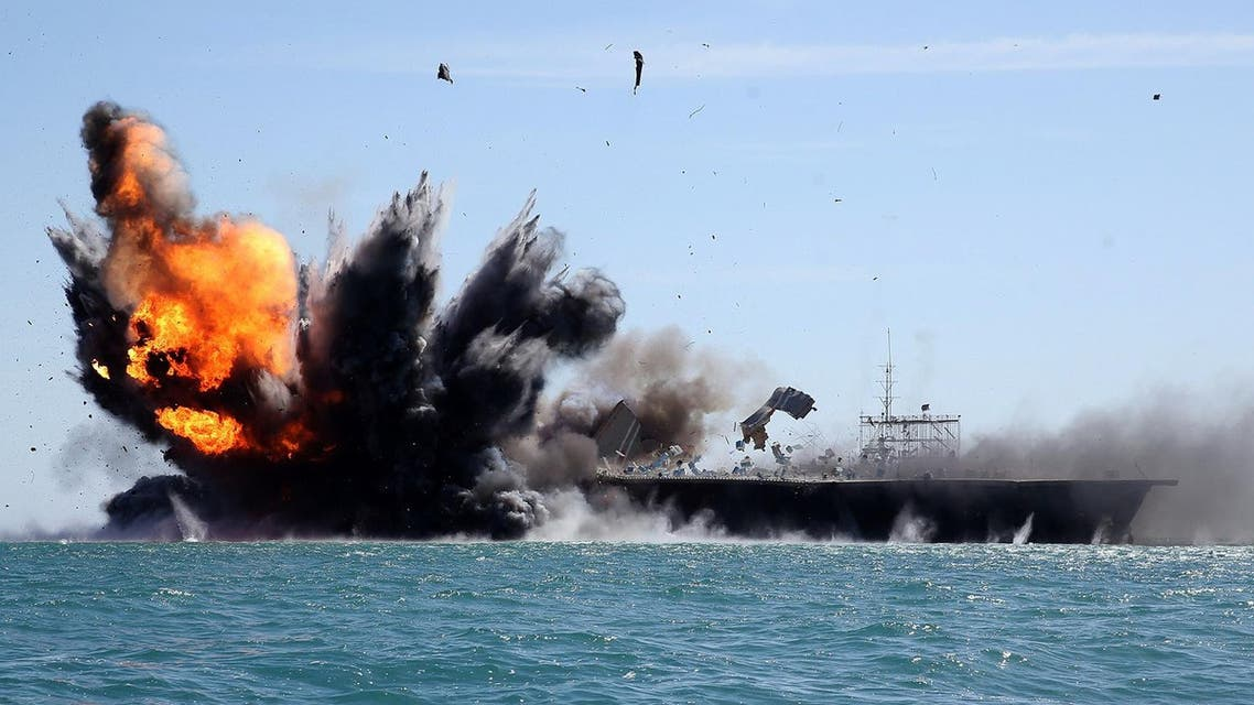 Iran's elite Revolutionary Guard troops attacks a naval vessel during a military drill in the Strait of Hormuz in southern Iran on February 25, 2015. (AFP)
