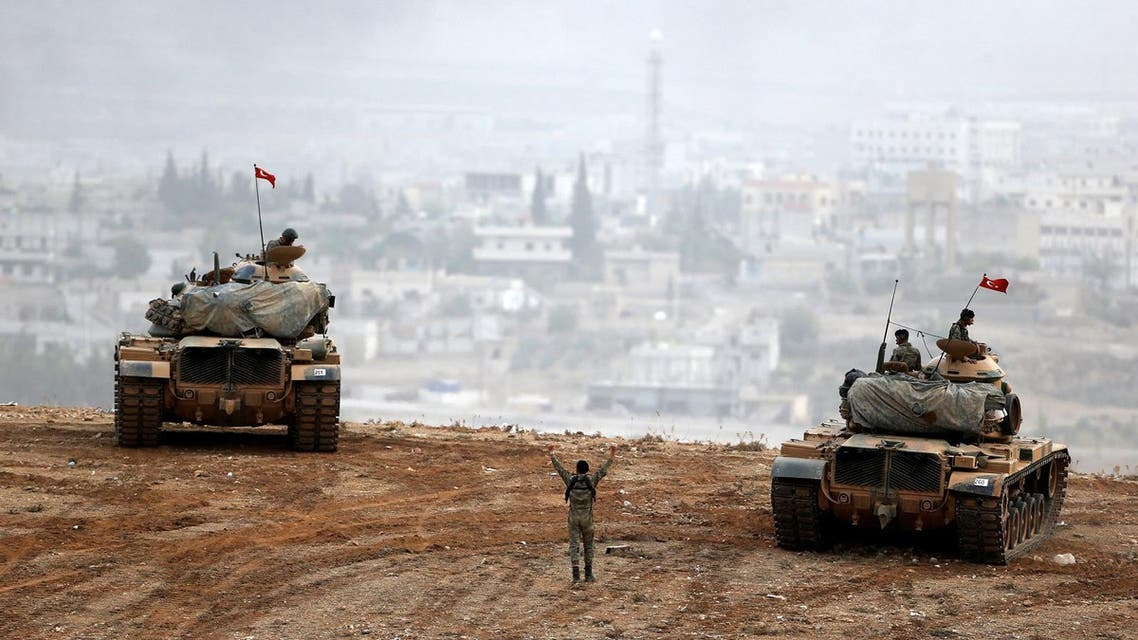 Turkish army tanks take position on top of a hill near Mursitpinar border crossing. (File photo: Reuters)