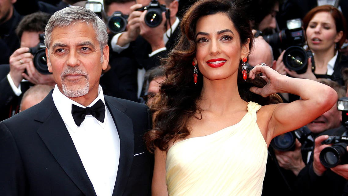 Cast member George Clooney and his wife Amal pose on the red carpet as they arrive during the 69th Cannes Film Festival in Cannes, France on May 12, 2016