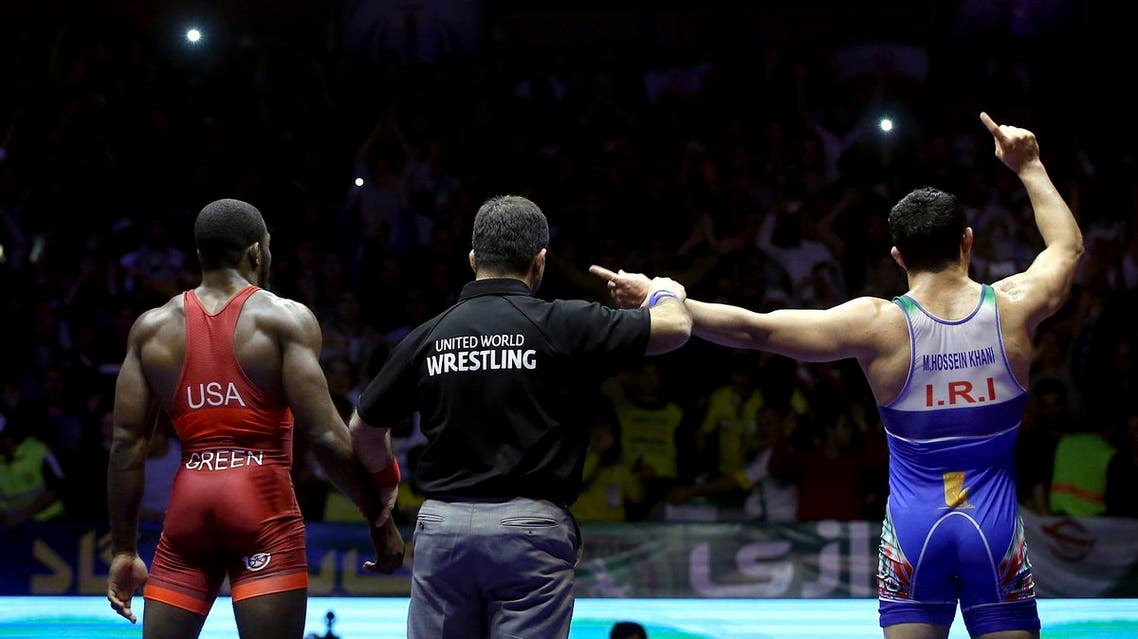 In this photo released by the Iran Newspaper, Iran's wrestler Mostafa Hossein Khani, right, celebrates after defeating United States' wrestler James Green during the men's freestyle 70 freestyle wrestling competition (Photo: Naeim Ahmadi, IIPA via AP)