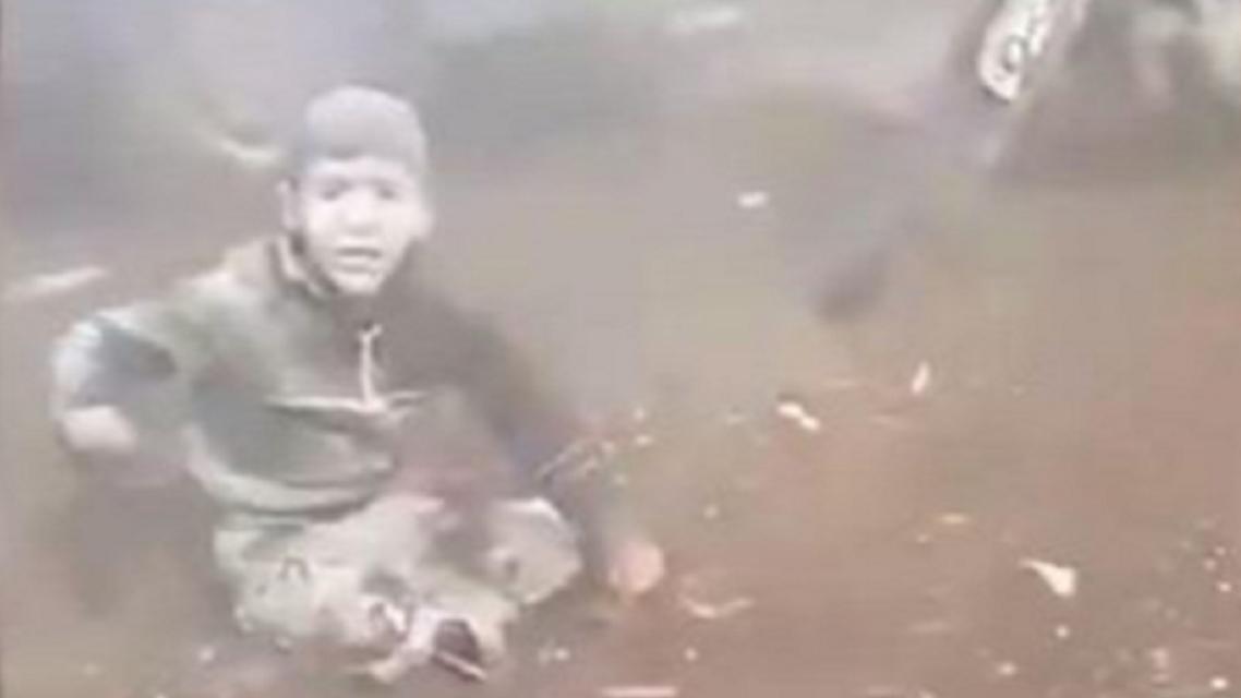 Syrian child calling for help following raid