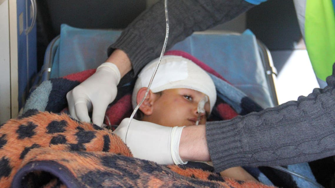 Nine-year-old Syrian Abdel Basset Al-Satuf (center) is seen inside an ambulance in the town of Al-Hbeit, in northwest Idlib province, on February 17, 2017, ahead of being transferred to Turkey for medical treatment . (AFP)