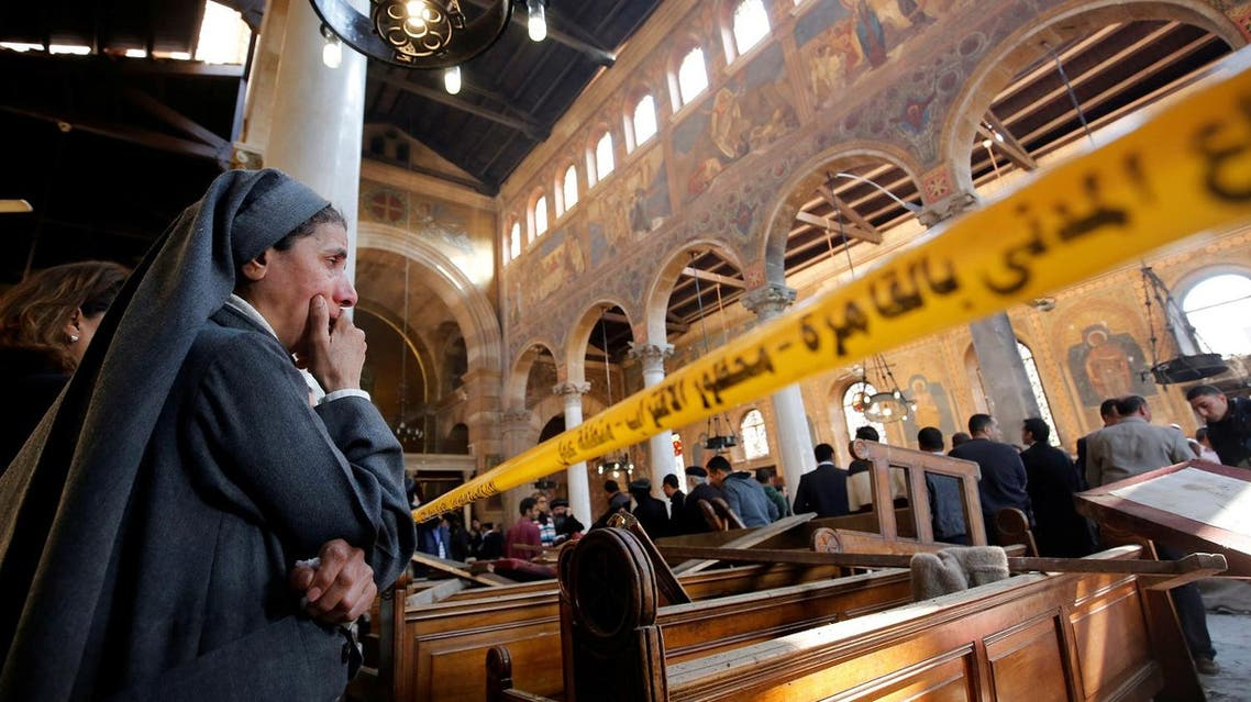 Coptic lady inside the bombed Cairo cathedral. (File photo/Reuters)