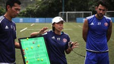 First woman to lead a men's football team, faces World Cup champion