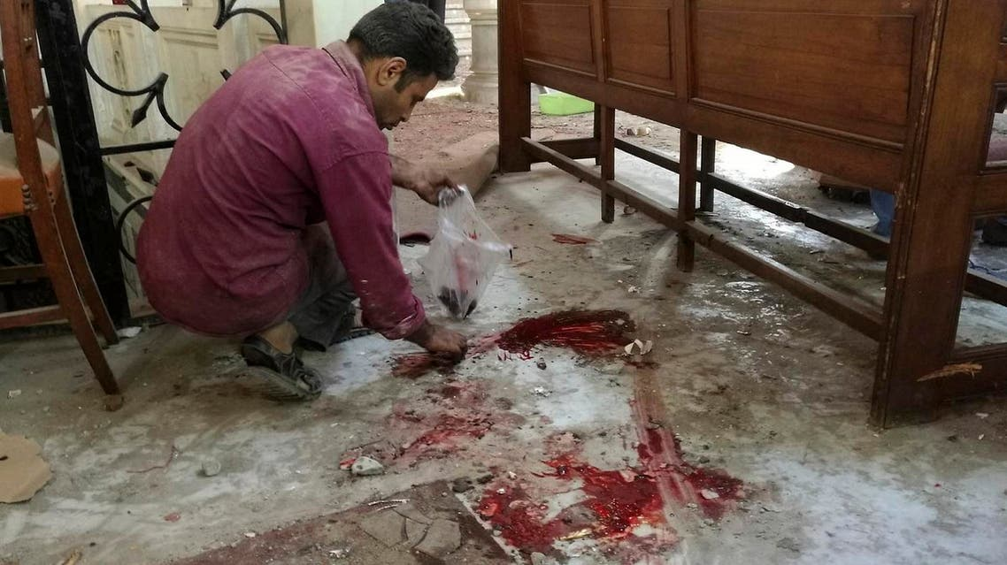 A worker cleans the scene inside St. Mark Cathedral - Egypt's main Coptic Christian cathedral - in central Cairo, following a bombing the killed dozens, Sunday, Dec. 11, 2016 (File Photo: Omar El-Hady via AP)