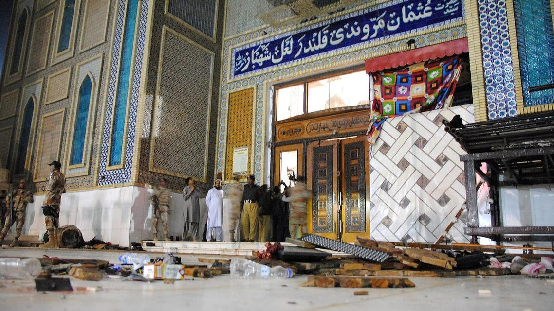 Debris are seen on the ground as Pakistani soldiers cordon off the shrine of 13th century Muslim Sufi Saint Lal Shahbaz Qalandar, after a bomb blew up in the town of Sehwan in Sindh province (File Photo:  Yousuf Nagori/AFP)
