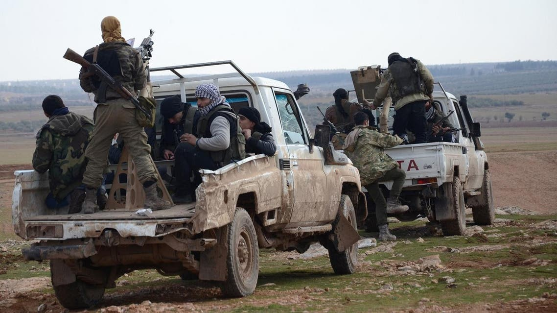 Fighters from the Free Syrian Army ride armoured pick up trucks during battles against Islamic State (IS) group jihadists near the town of Qabasin, located northeast of the city of Al-Bab, some 30 kilometres from Aleppo, on January 8, 2017.  Nazeer al-Khatib / AFP