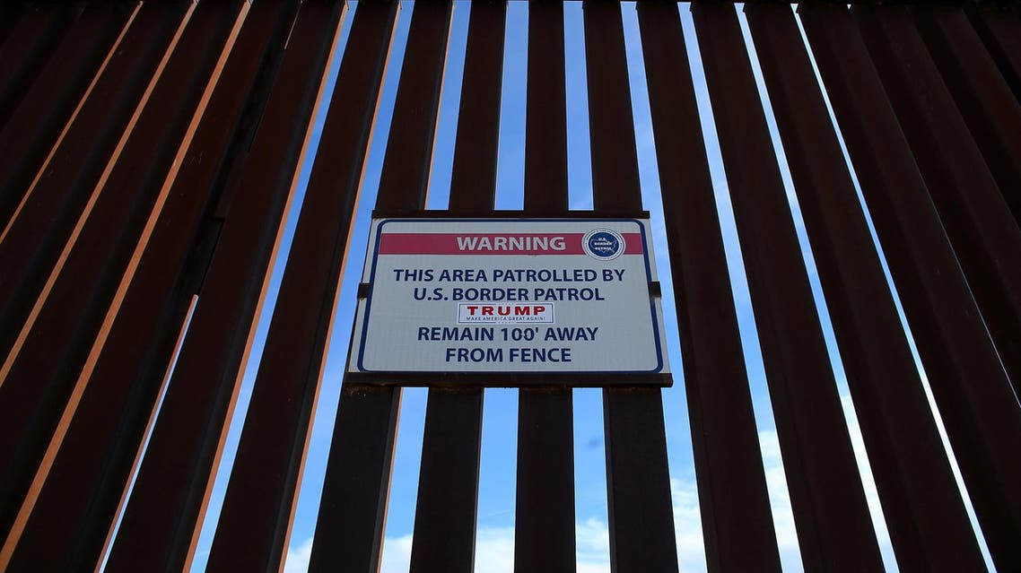 A Donald Trump for President campaign sticker is shown attached to a U.S. Customs sign hanging on the border fence between Mexico and the United States near Calexico, California, U.S. February 8, 2017. Picture taken February 8, 2017. (Reuters)