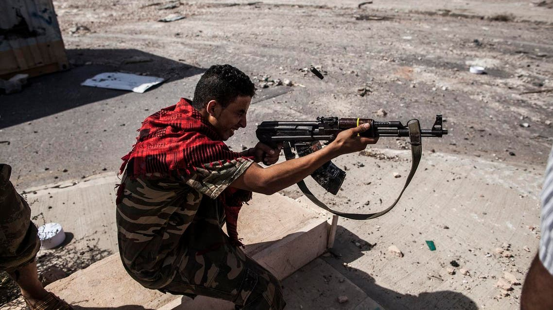 A fighter of the Libyan forces shoots against ISIS positions, in Sirte, Libya, Thursday, Sept. 22, 2016. (AP)