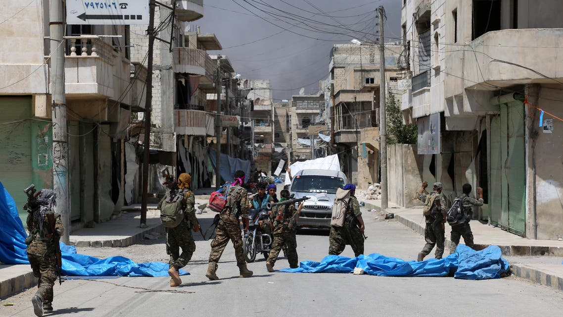 Members of the Syrian Democratic Forces (SDF) patrol a street in the northern Syrian town of Manbij on August 7, 2016, as they comb the city in search of the last remaining jihadists, a day after they retook it from the Islamic State group