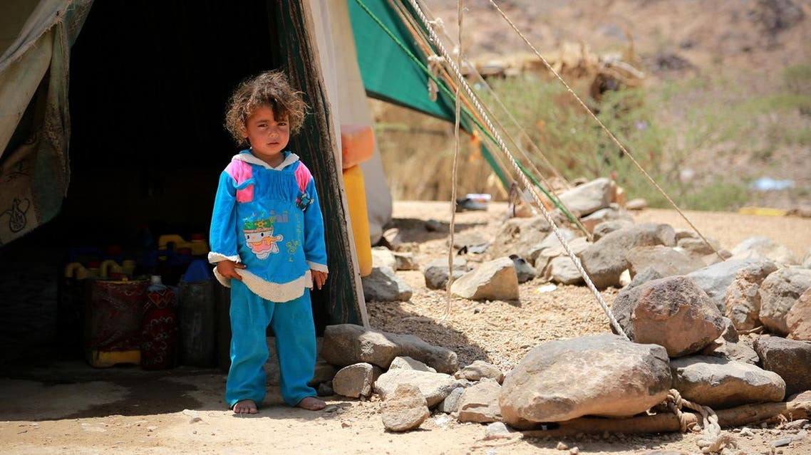 A Yemeni child stands outside a tent at a makeshift camp for Internally Displaced Persons (IDPs) after many were forced to flee their homes due to the ongoing fighting in the country, in the Nehm region, west of Marib city, on May 8, 2016.  ABDULLAH AL-QADRY / AFP