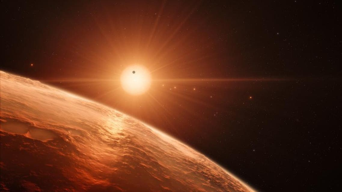 Artist's impression released by the European Southern Observatory on February 22, 2017, shows the view just above the surface of one of the planets in the TRAPPIST-1 system. (AFP)