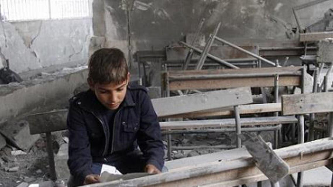 صورة نشرتها منظمة هيومن رايتس ووتش لتلميذ سوري في مدرسته المدمّرة عام 2012