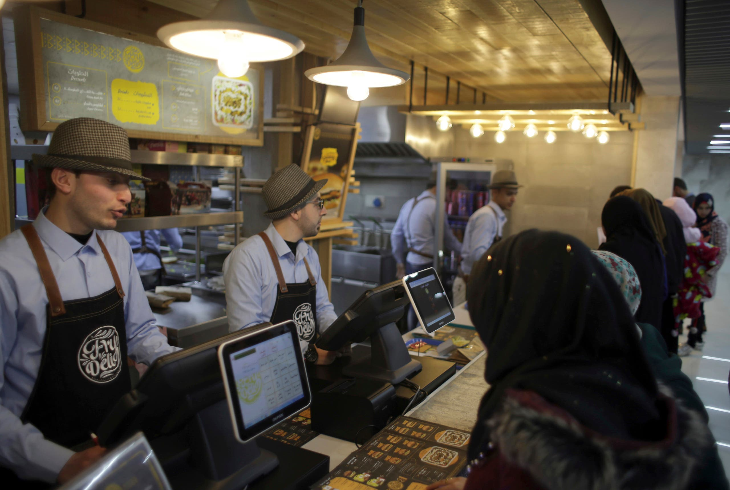 Palestinians buy fast food from the food court in the first indoor shopping mall in the Gaza Strip, in Gaza City. (AP)