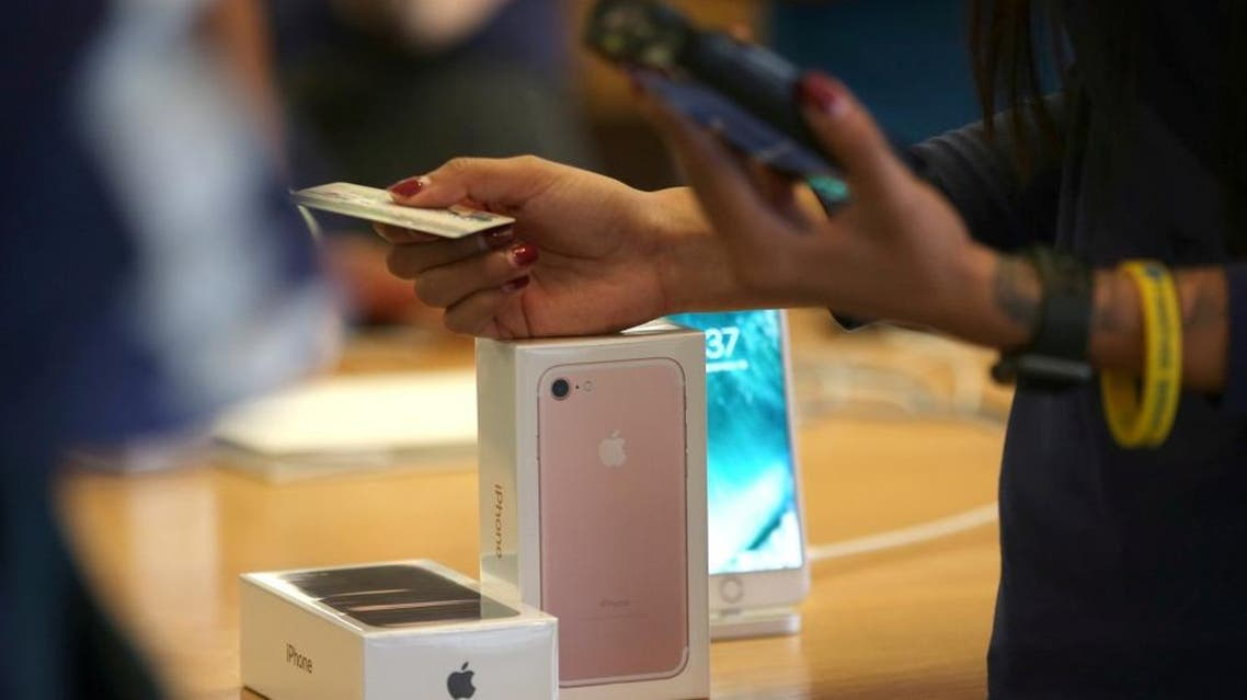 A customer buys the new iPhone 7 smartphone inside an Apple Inc. store in Los Angeles, California, U.S. on September 16, 2016. REUTERS