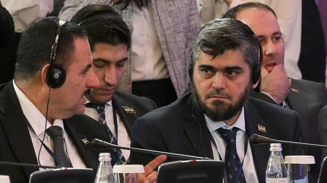Chief opposition negotiator Mohammad Alloush (R) of the Jaish al-Islam (Army of Islam) rebel group speaks with his colleague during the second session of Syria peace talks at the Rixos President Hotel in Astana, on February 16, 2017. (AFP)