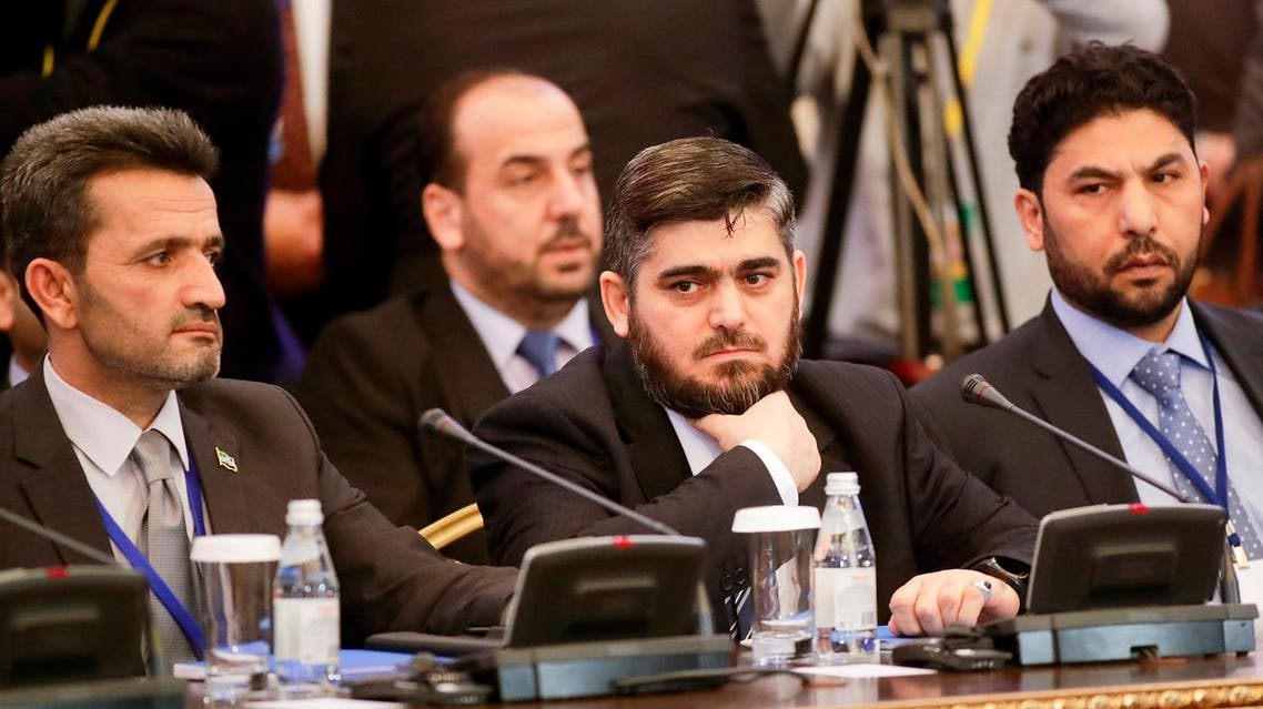 Mohammed Alloush, center, head of a Syrian opposition delegation, and other members attend talks on Syrian peace in Astana, Kazakhstan, Monday, Jan. 23, 2017. The talks are the latest attempt to forge a political settlement to end a war that has by most estimates killed more than 400,000 people since March 2011 and displaced more than half the country's population. (AP