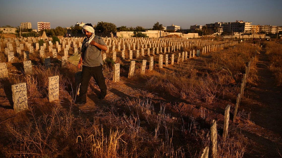 """The bodies of some 130 fighters shot execution-style or beheaded by rival extremists have been found in mass graves in northwestern Syria, a monitoring group and rebel sources said Thursday. The grim discovery comes nearly a week after clashes in Idlib province between the extremist Jund al-Aqsa rebel group and Al-Qaeda's former Syrian affiliate and allied factions. At least 131 bodies were found on Wednesday and Thursday in two separate mass graves near the town of Khan Sheikun, said the Syrian Observatory for Human Rights. Some had been shot and others beheaded. Last week the bodies of 41 rebel fighters had been found near the same town, said the Britain-based monitoring group. Observatory director Rami Abdel Rahman said Jund al-Aqsa had detained the fighters and then """"executed"""" them. Mohammad Rashid, a spokesman for the rebel Jaish al-Nasr group, also reported the deaths but put the number of bodies found at 128. According to him, 71 of those killed were fighters from his group. """"Three citizen journalists and 11 commanders were among them,"""" said Rashid. A source from the civil defence also reported that 128 bodies had been recovered from two graves inside a former army barracks that had been occupied by Jund al-Aqsa. Jund al-Aqsa, which is considered close to ISIS, is reviled by most rebels in the region and is designated a """"terrorist group"""" by Washington. Earlier this month, Jund al-Aqsa had been locked in clashes with Fateh al-Sham, the former Al-Qaeda affiliate in Syria, after tensions over influence in Idlib, a province held by rebels. Fateh al-Sham was fighting alongside several allied groups in a coalition dubbed Tahrir al-Sham, and the battles spread beyond Idlib to neighboring Hama province. According to the Observatory, Jund al-Aqsa fighters have pulled back to Hama and to other areas. More than 310,000 people have been killed in Syria since the conflict began in March 2011 with anti-government protests. The war has become a complex multi-front conflict,"""