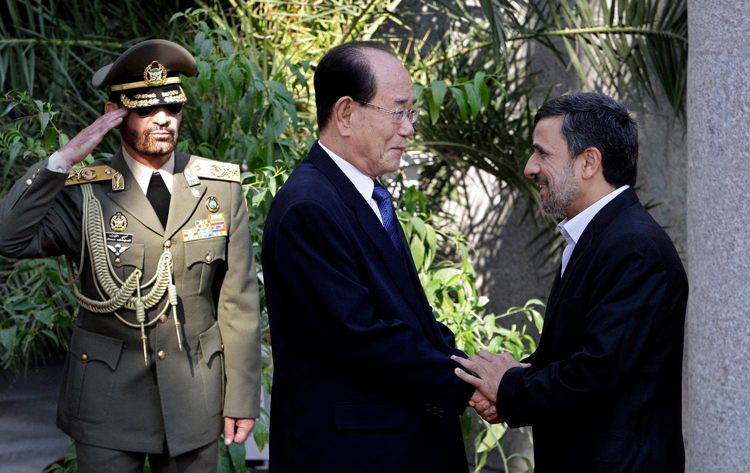 Mahmoud Ahmadinejad shakes hands with the president of the Presidium of North Korea's Supreme People's Assembly Kim Yong-nam, during a welcoming ceremony in Tehran, Iran, Saturday, Sept. 1, 2012. (AP)