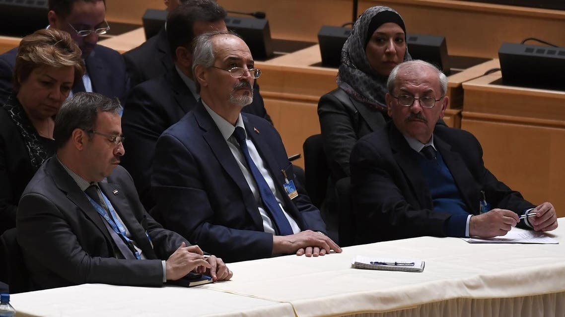 Syria's United Nations (UN) ambassador and head of the government delegation Bashar al-Jaafari (C) sits next to government delegation members while UN Syria envoy Staffan de Mistura (not seen) welcomes both delegation at the opening of a new round of Syria peace talks on February 23, 2017 in Geneva. (AFP)
