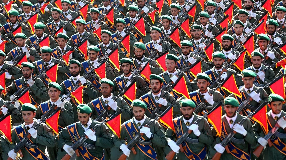 Iran's Revolutionary Guard troops march in a military parade marking the 36th anniversary of Iraq's 1980 invasion of Iran, in front of the shrine of late revolutionary founder Ayatollah Khomeini, just outside Tehran, Iran, Wednesday, Sept. 21, 2016. (AP)