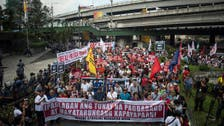 Hundreds on Philippine streets as Duterte jails top critic
