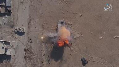شاهد.. درون داعشي يقصف مدرعة عراقية