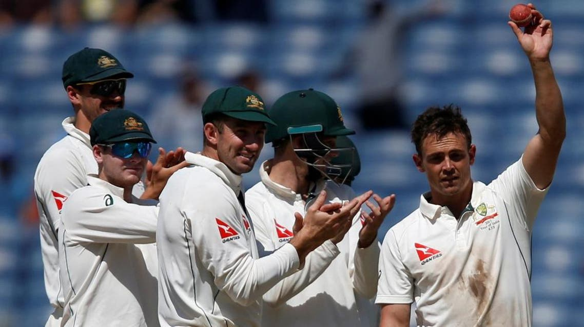 Australia's Steve O'Keefe celebrates with team mates the wicket of India's Wriddhiman Saha. (Reuters)