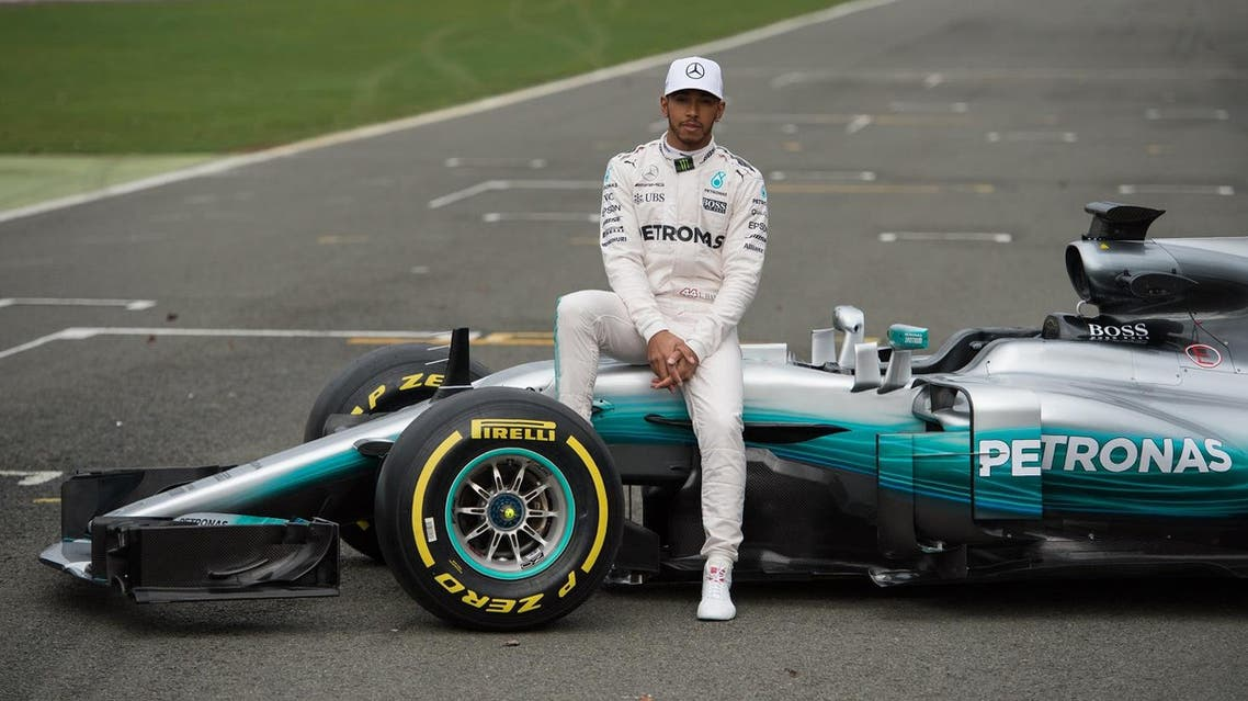 Mercedes AMG Petronas Formula One driver Britain's Lewis Hamilton poses by the new 2017 season Mercedes W08 EQ Power+ Formula One car at its launch event at Silverstone motor racing circuit near Towcester, central England on February 23, 2017. (AFP)
