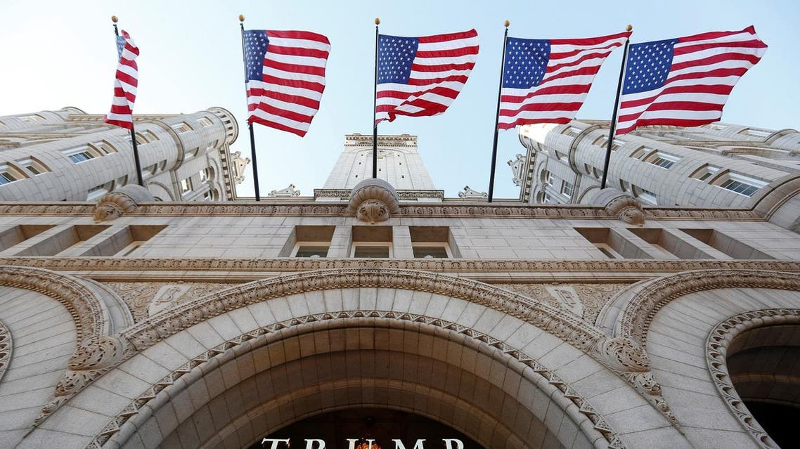 Flags fly above the entrance to the new Trump International Hotel on its opening day in Washington, DC. (File photo: Reuters)
