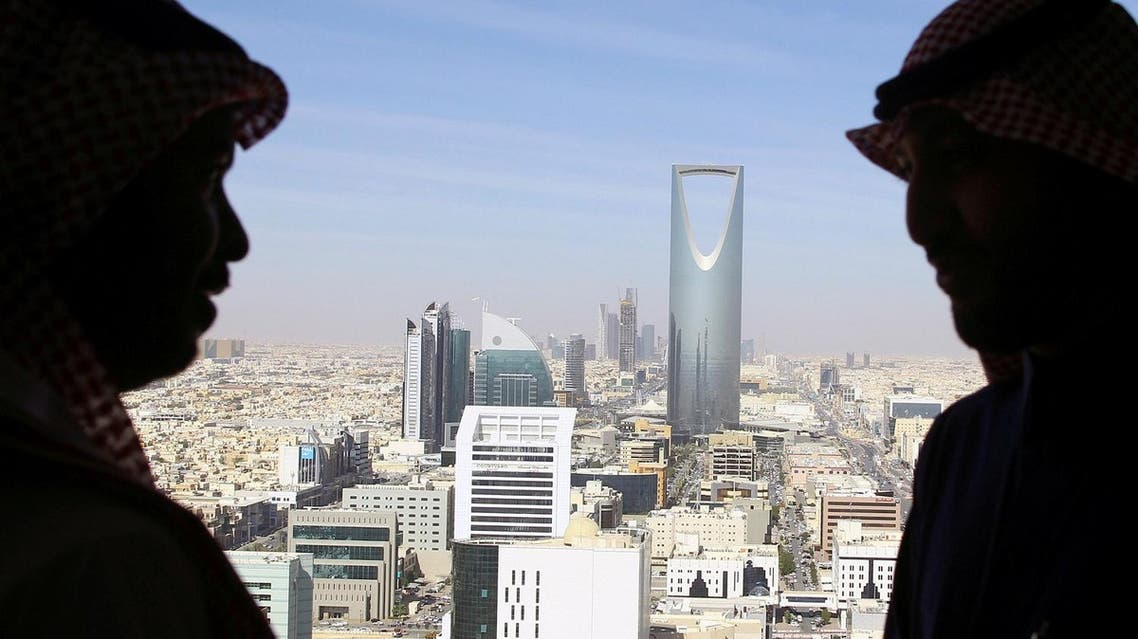 Men look out of a building at the Kingdom Centre Tower in Riyadh, Saudi Arabia, January 1, 2017. (Reuters)